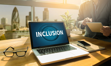 Laptop with the word Inclusion