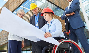 construction workers with woman using a wheelchair