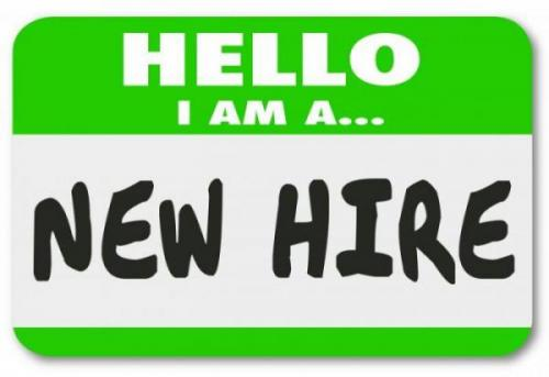 """Hello I'm a """"New Hire"""" written on name label"""