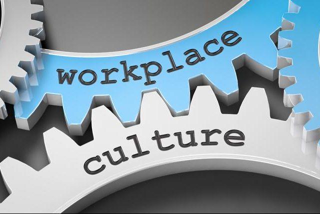 Workplace culture written on cogs