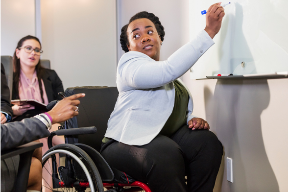 woman in wheelchair at whiteboard