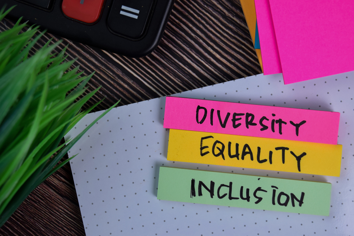 Inclusion write on a sticky note isolated on Office Desk